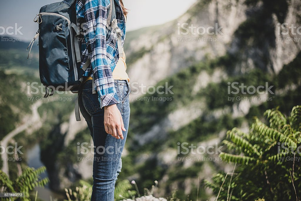 Woman mountain Hiker with backpack stock photo