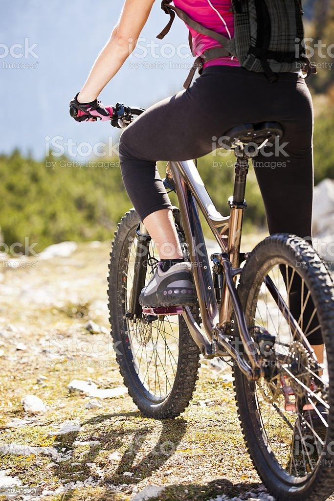 Woman mountainbiker on mountain bike royalty-free stock photo