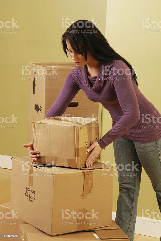 Woman moving boxes royalty-free stock photo