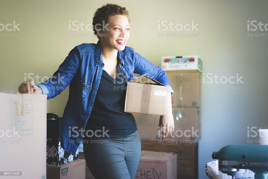 Woman Moving Boxes stock photo