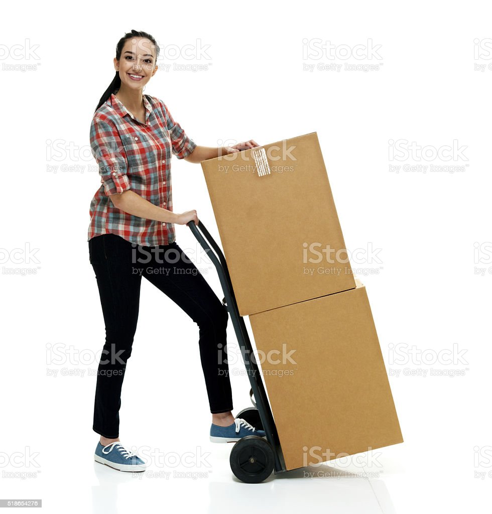 Woman  moving cardboard boxes stock photo
