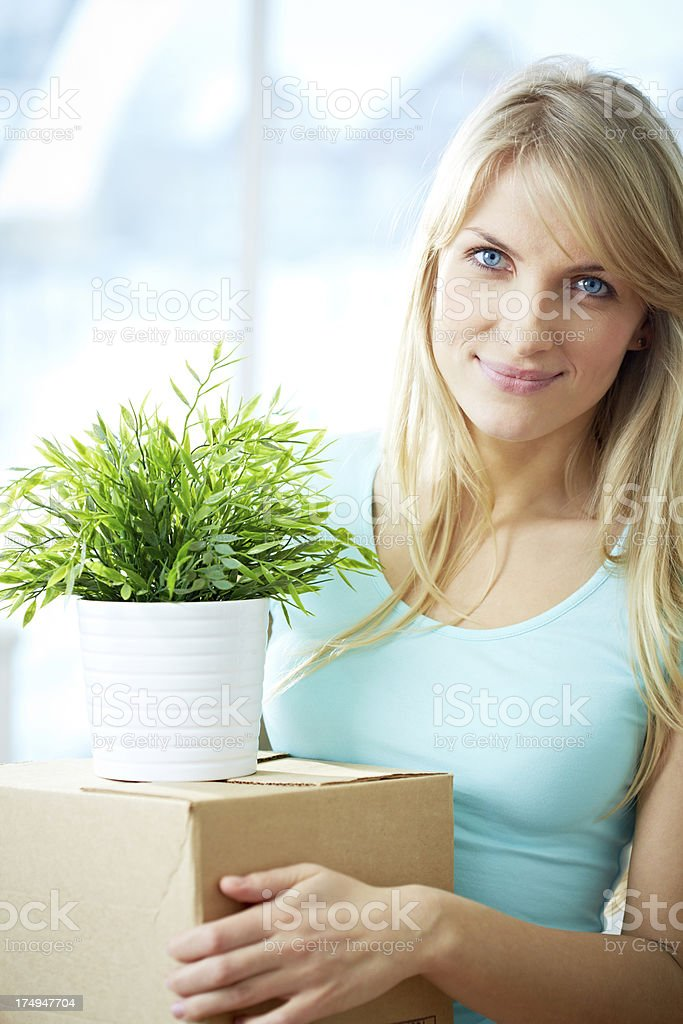Woman moving house royalty-free stock photo