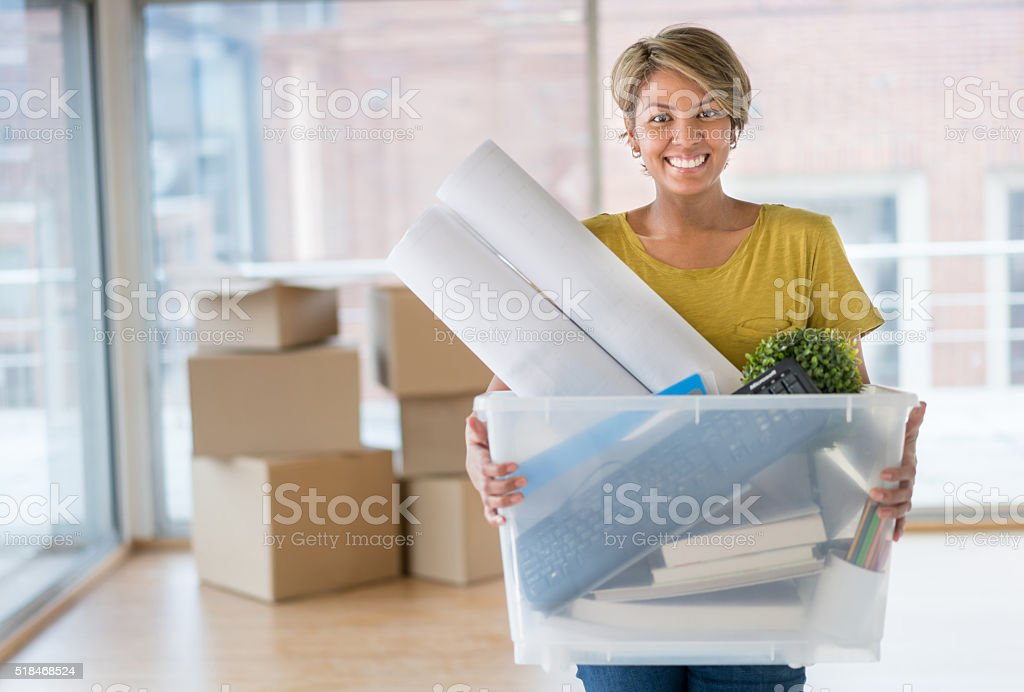Woman moving house stock photo