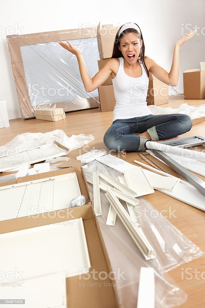 woman moving in - furniture assembly frustration royalty-free stock photo