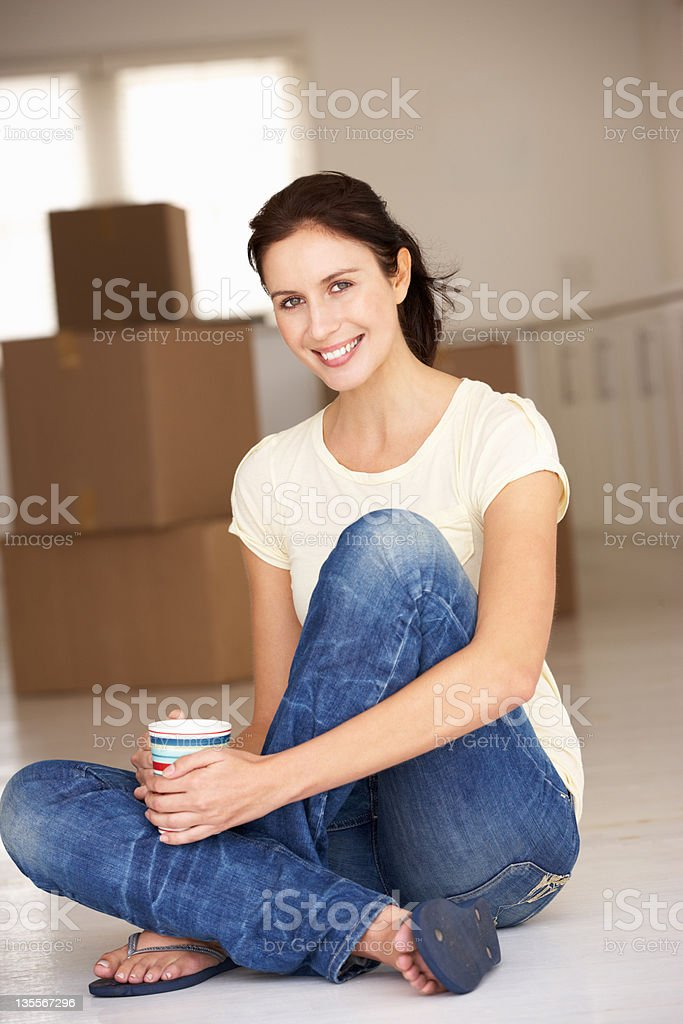Woman moving into new home royalty-free stock photo