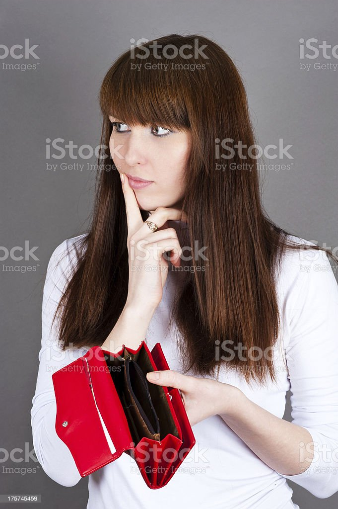 woman much thought holding a purse royalty-free stock photo