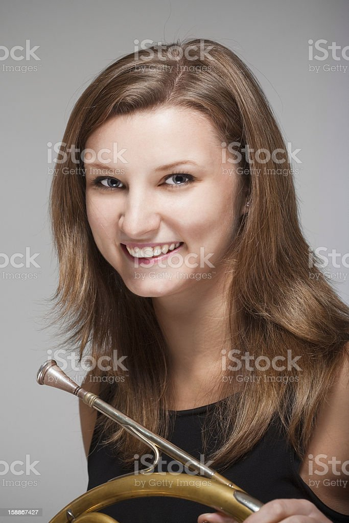 woman musician with french horn royalty-free stock photo