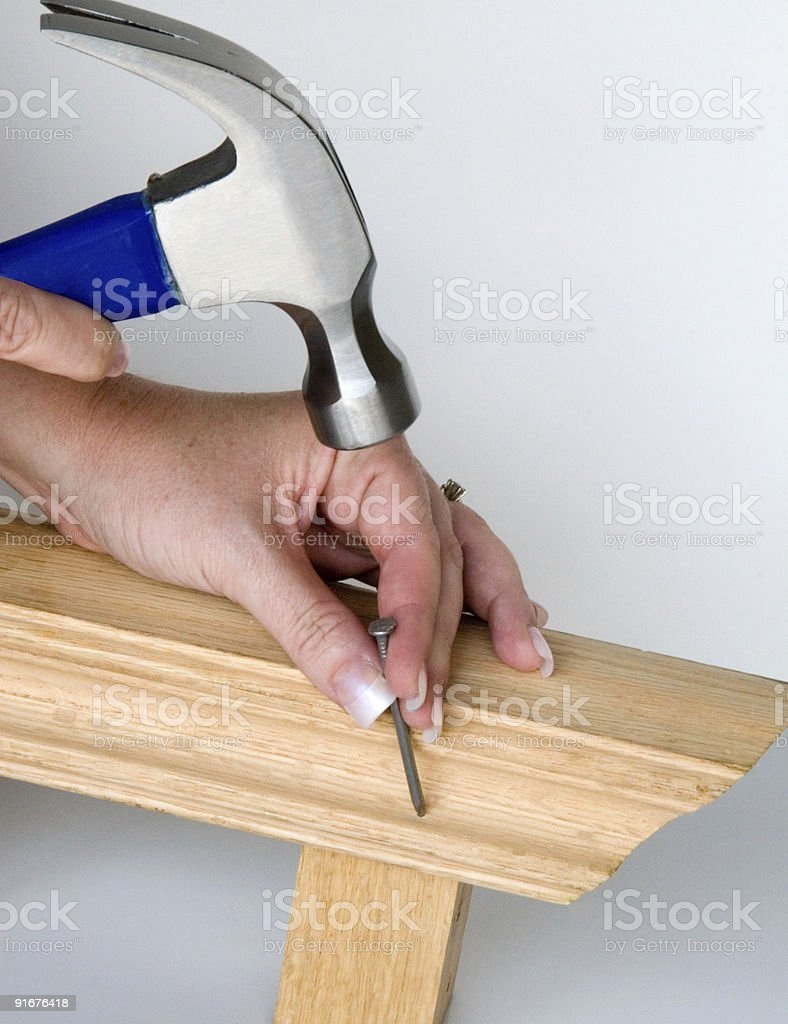 Woman Nailing Wood royalty-free stock photo