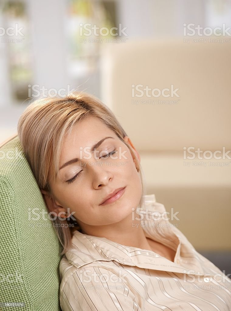 Woman napping in armchair at home royalty-free stock photo