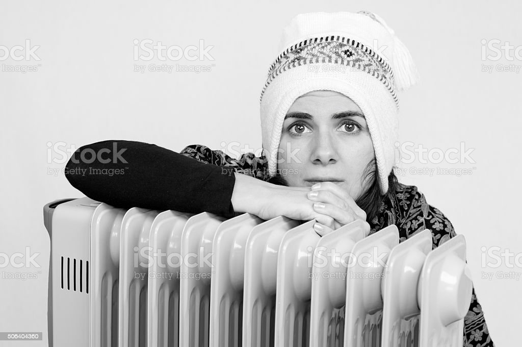 Woman near a heater stock photo