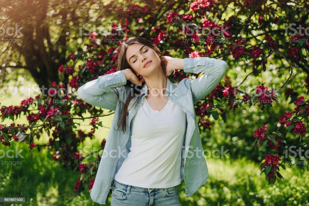 Woman near blooming apple tree stock photo