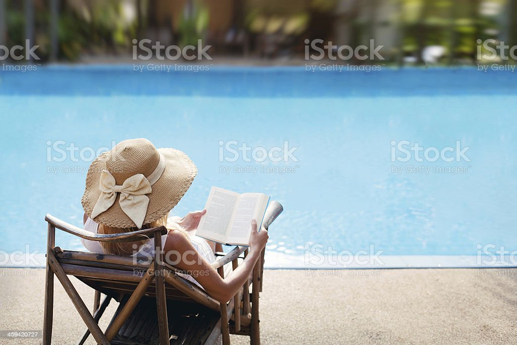 woman near luxury swimming pool stock photo