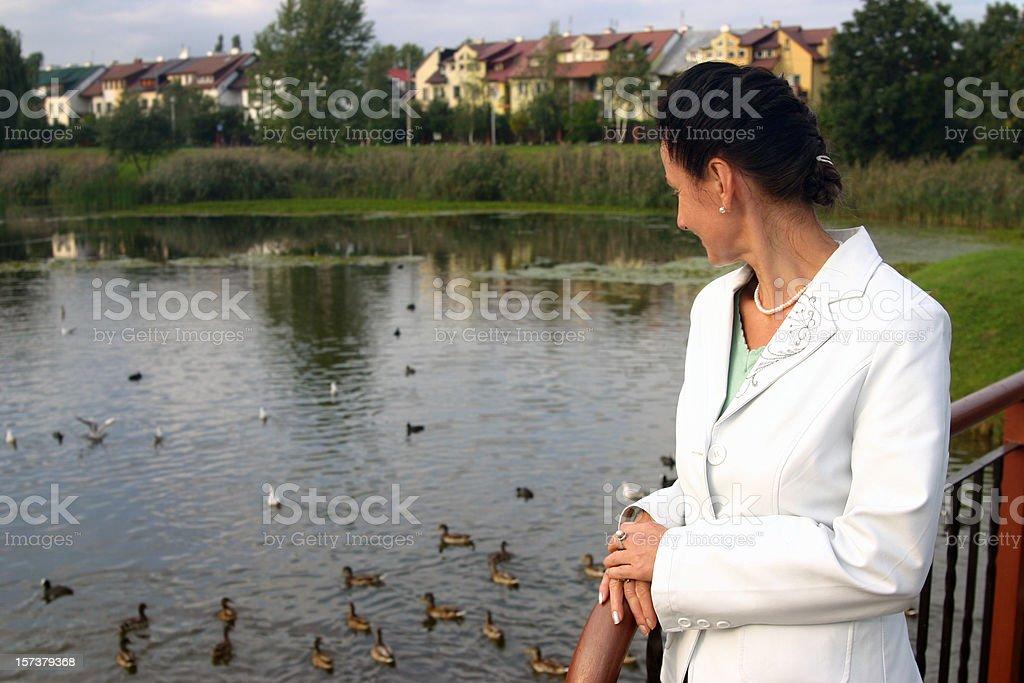 Woman near pond stock photo