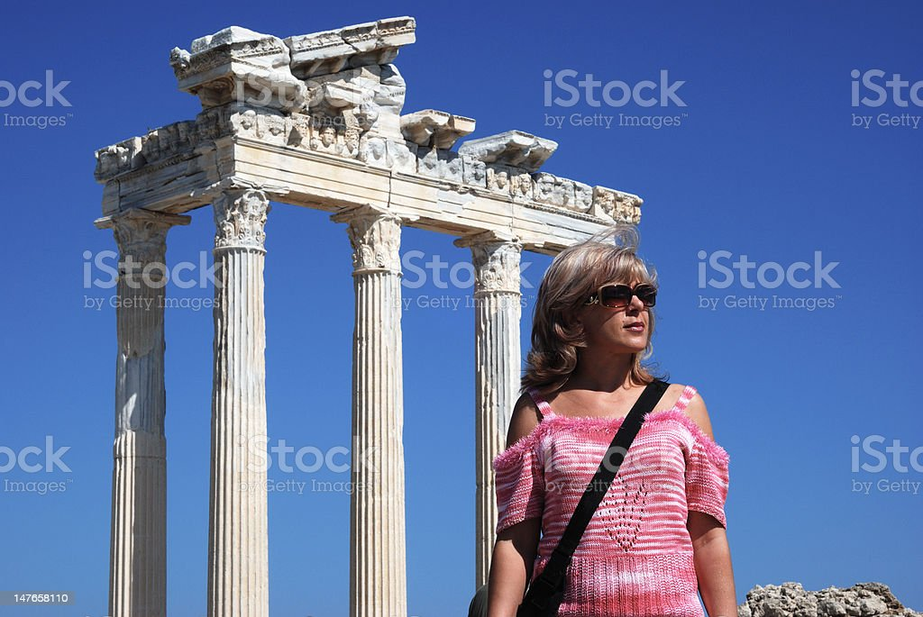 Woman near the antique ruins royalty-free stock photo