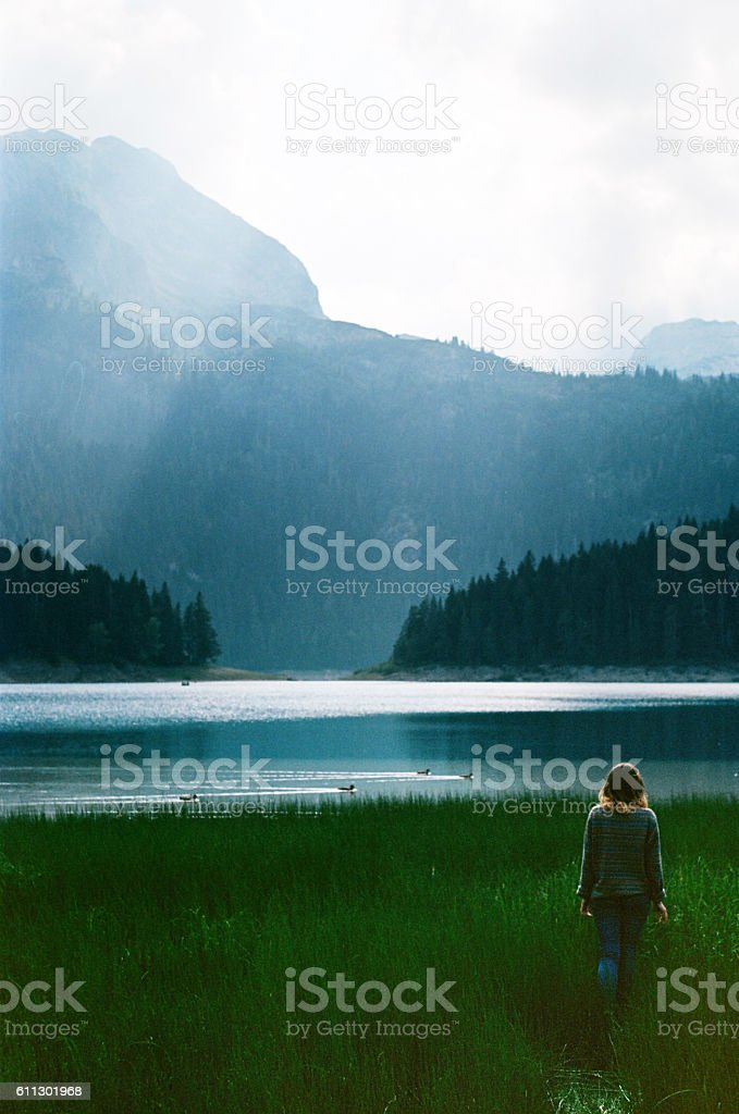 Woman near the Black lake stock photo