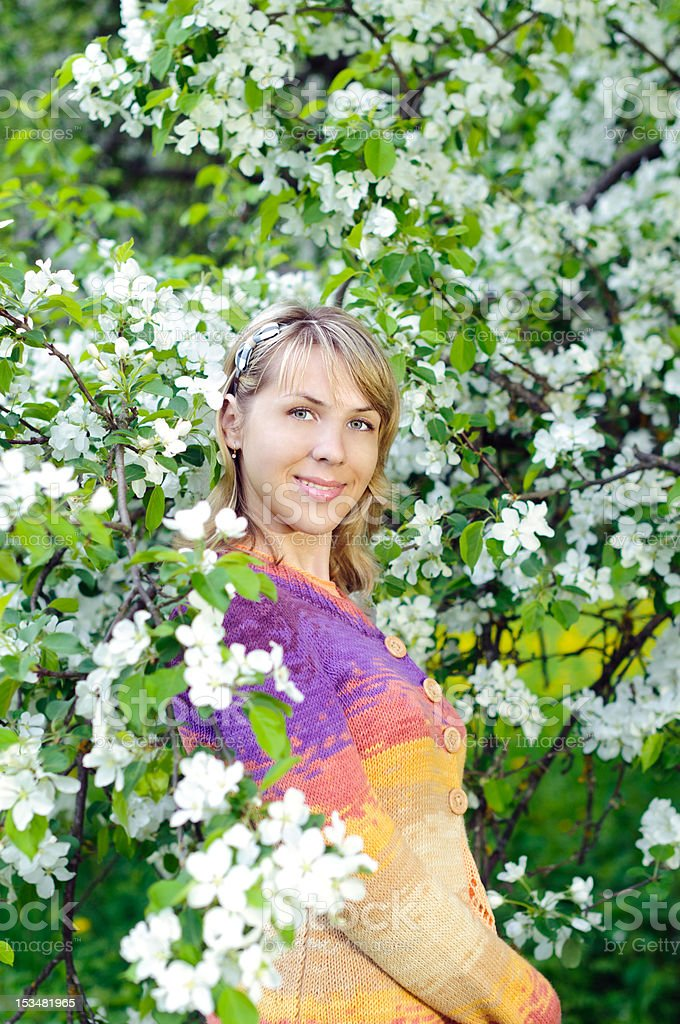 woman near the blooming tree royalty-free stock photo