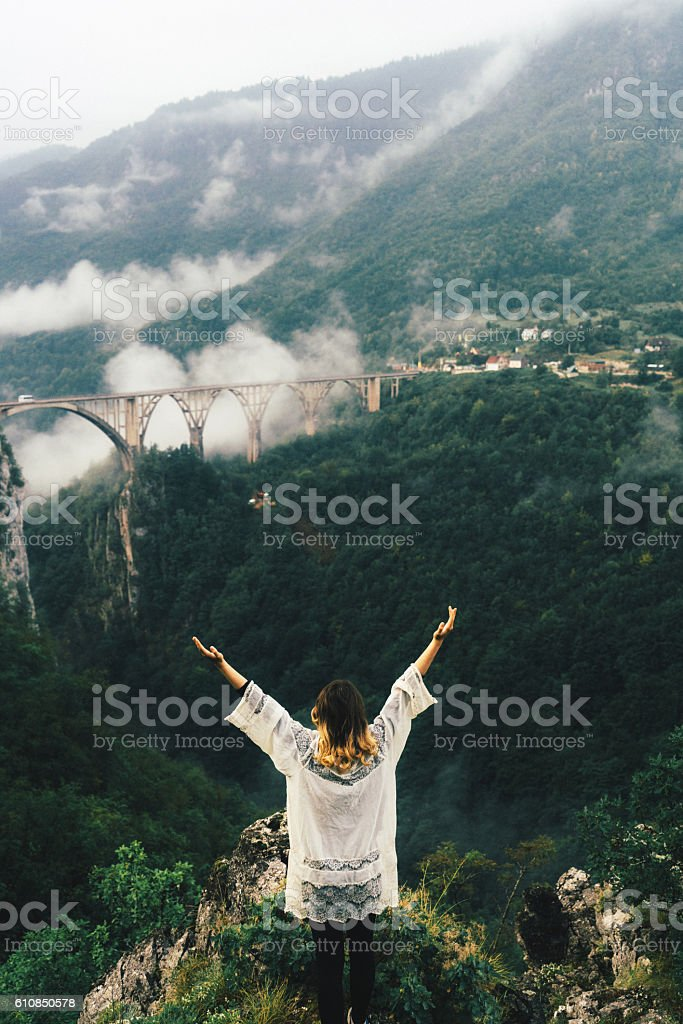 Woman near the bridge on Tara river stock photo