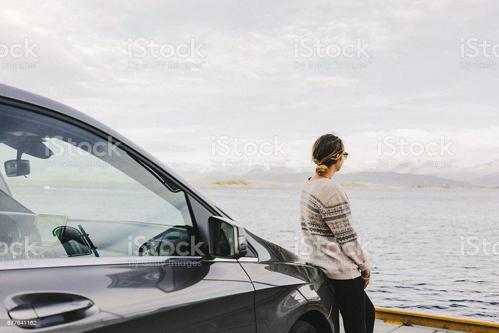 Woman near the car stock photo