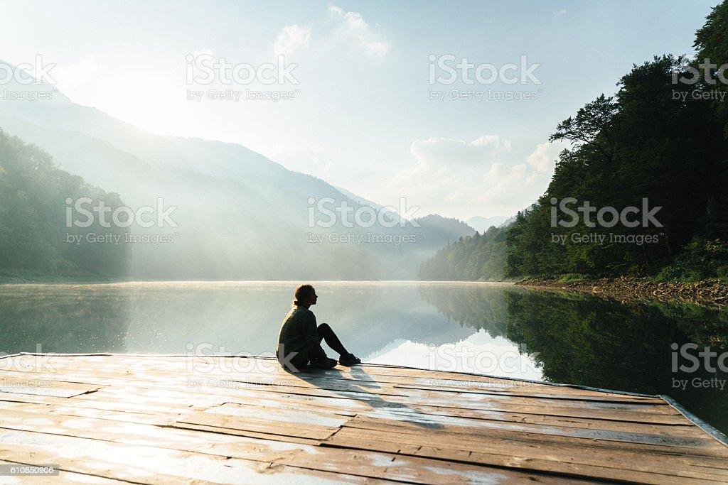 Woman near the lake in mountains stock photo