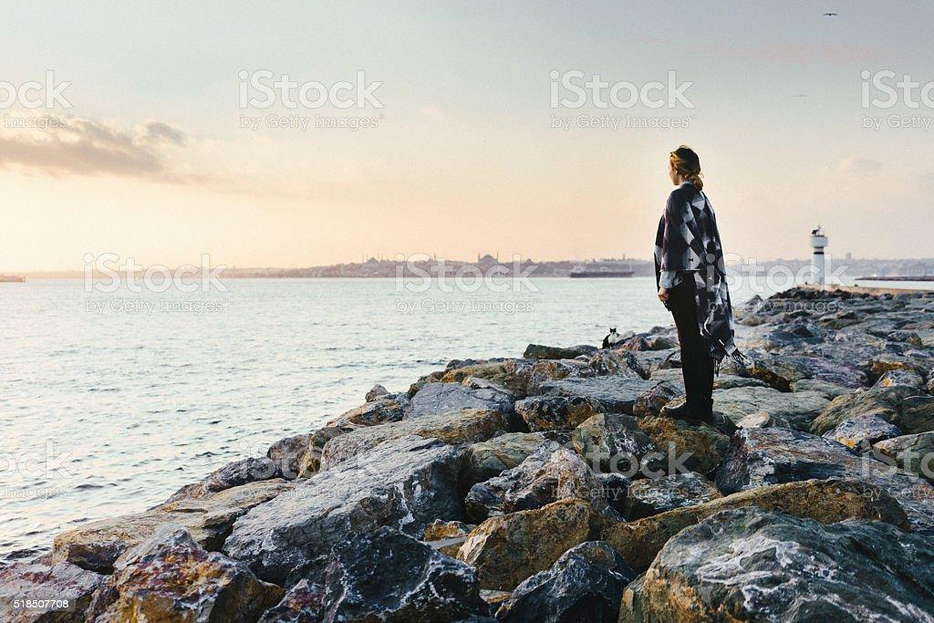 Woman near the sea stock photo