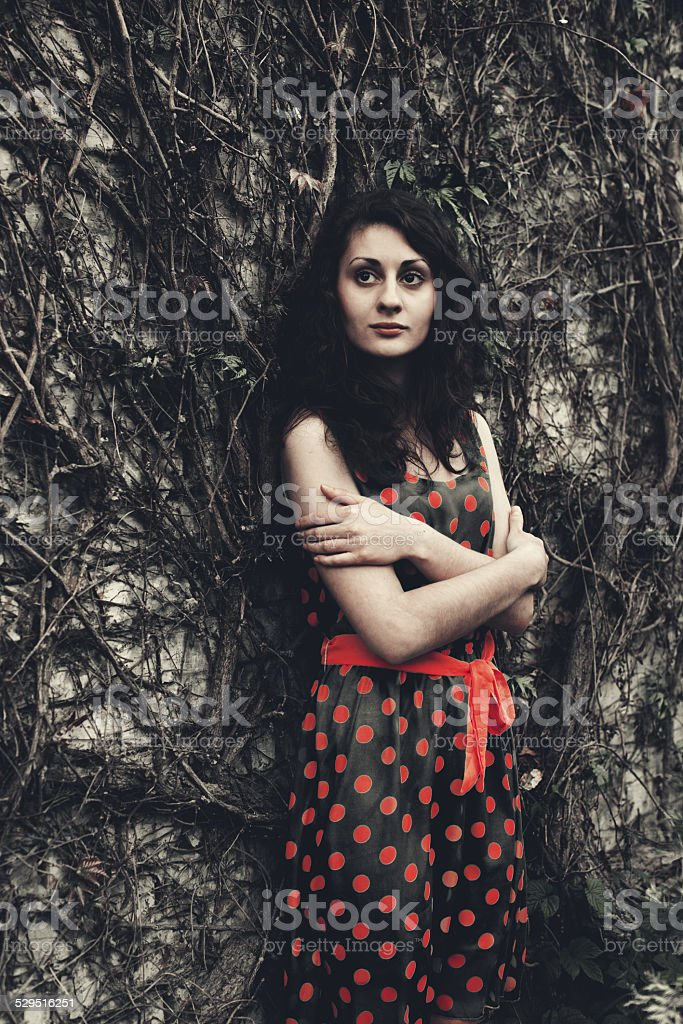 Woman near the wall royalty-free stock photo