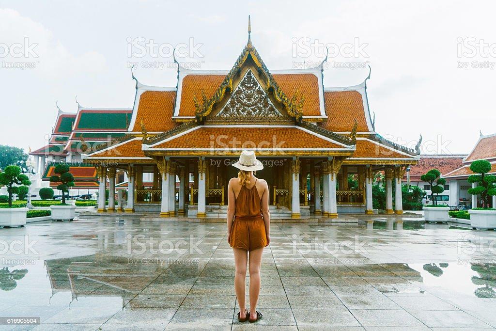 Woman near the Wat Ratchanatdaram in Bangkok stock photo