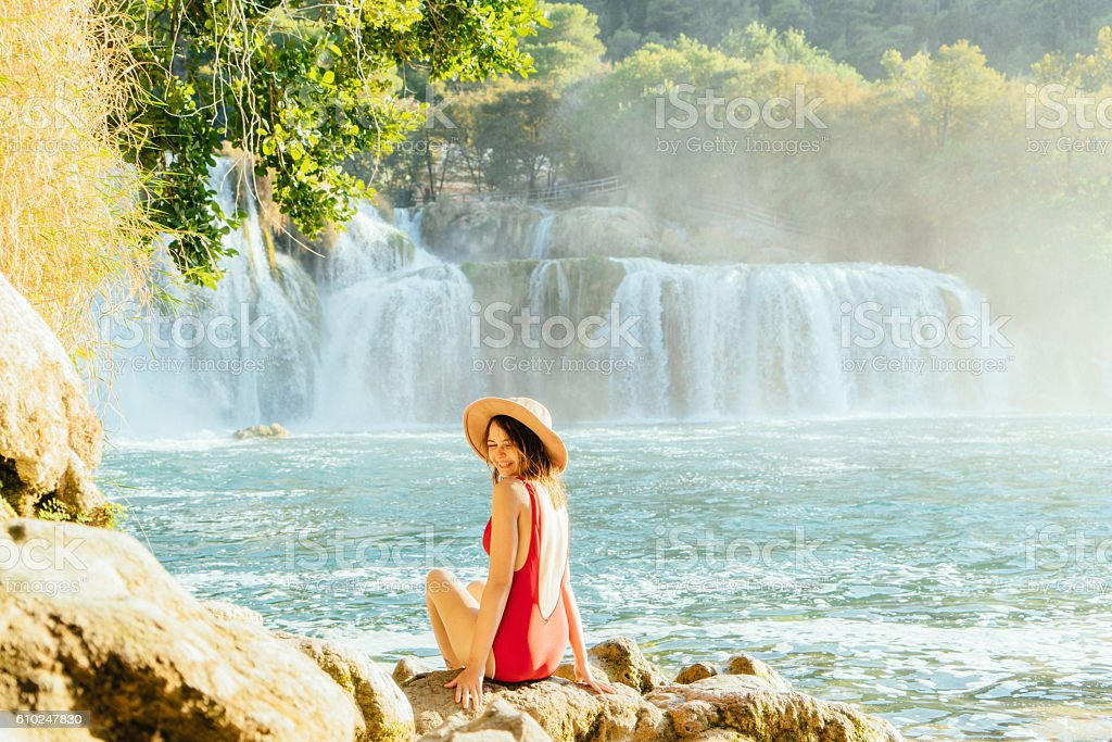 Woman near the waterfall Krka National Park stock photo