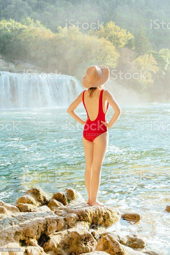Woman near the waterfall Krka National Park stock photo