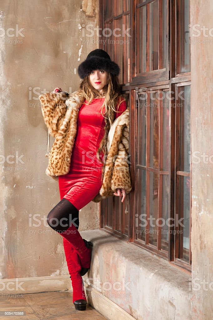 Woman near the window stock photo