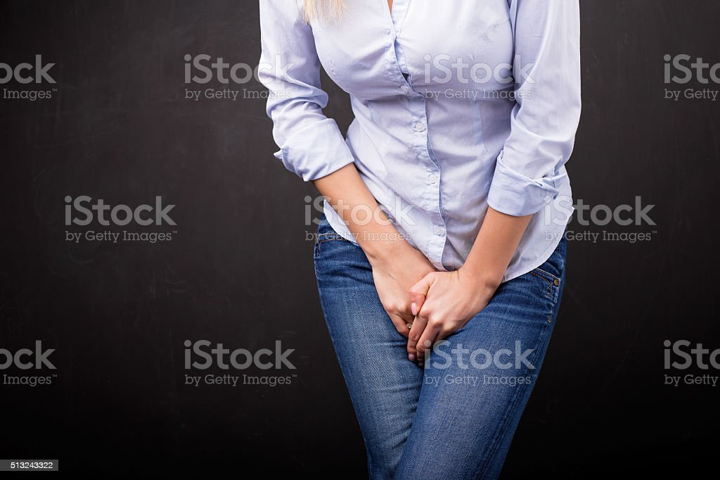 Woman needs to pee stock photo