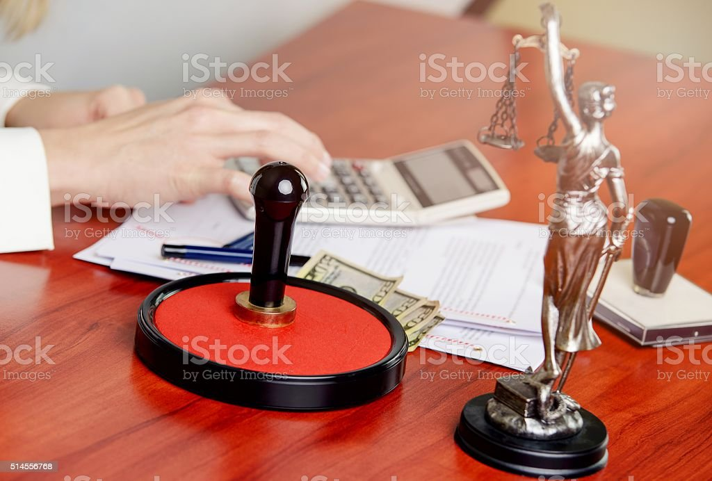 Woman Notary Public calculates the cost stock photo