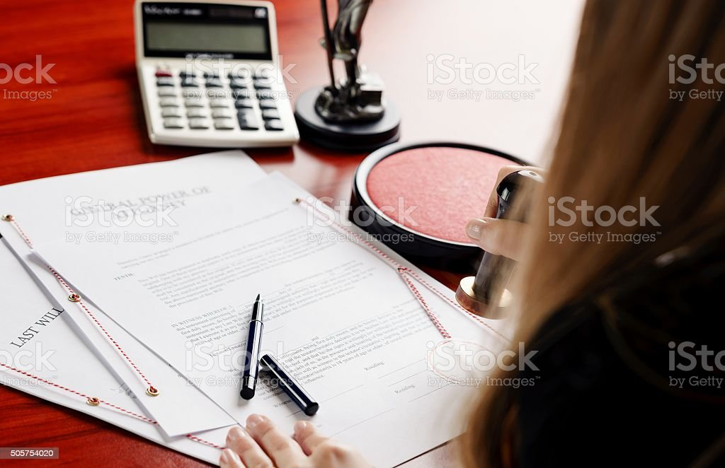 Woman notary public notarize document stock photo