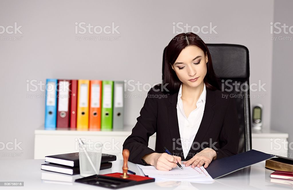 Woman notary public notarizes the document stock photo