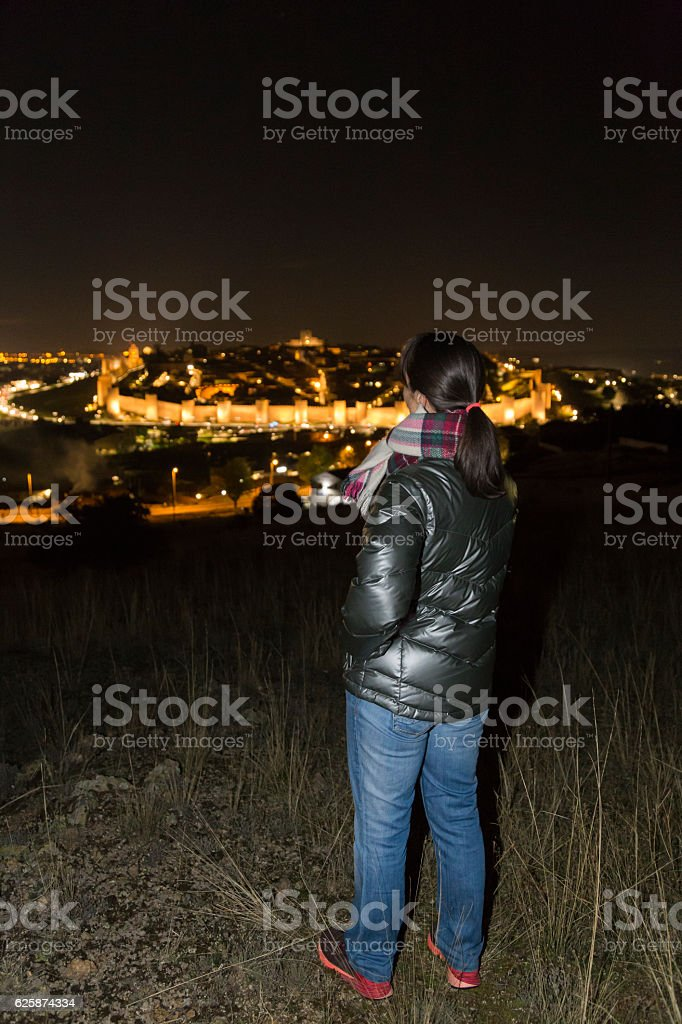 Woman observing night view of the city stock photo
