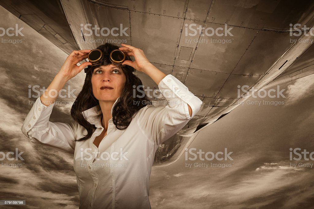 woman observing plane stock photo
