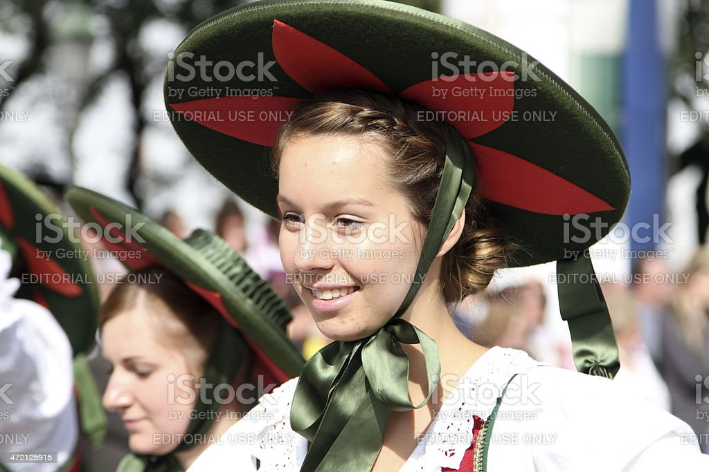 woman of ribbon circle with green red hat oktoberfest stock photo
