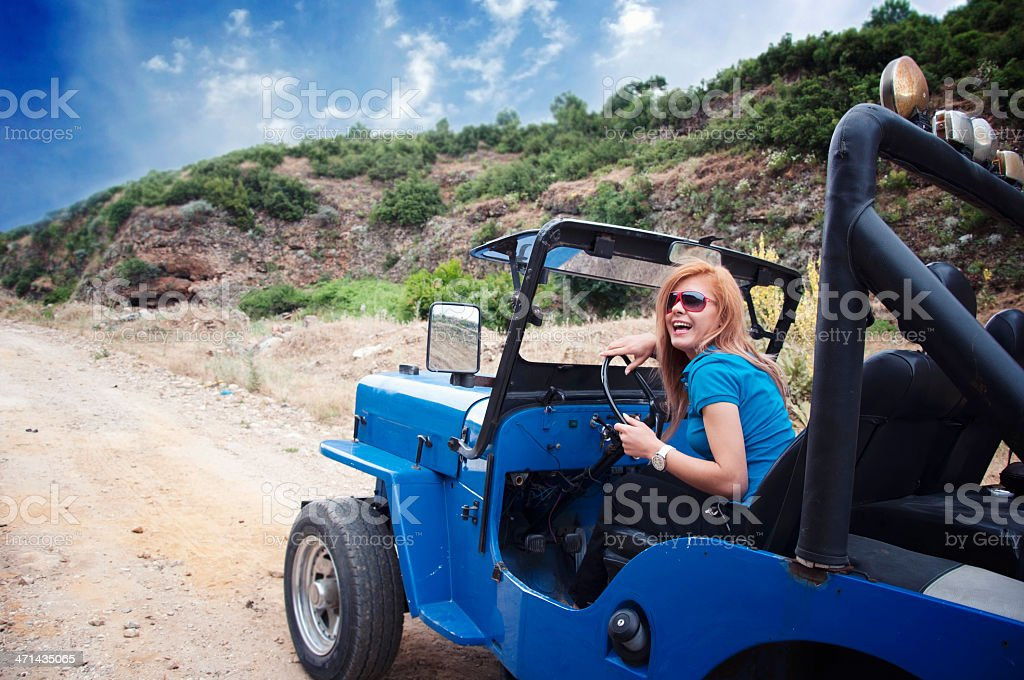 Woman off road driving royalty-free stock photo