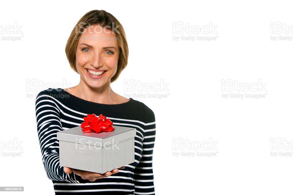 Woman offering a gift stock photo