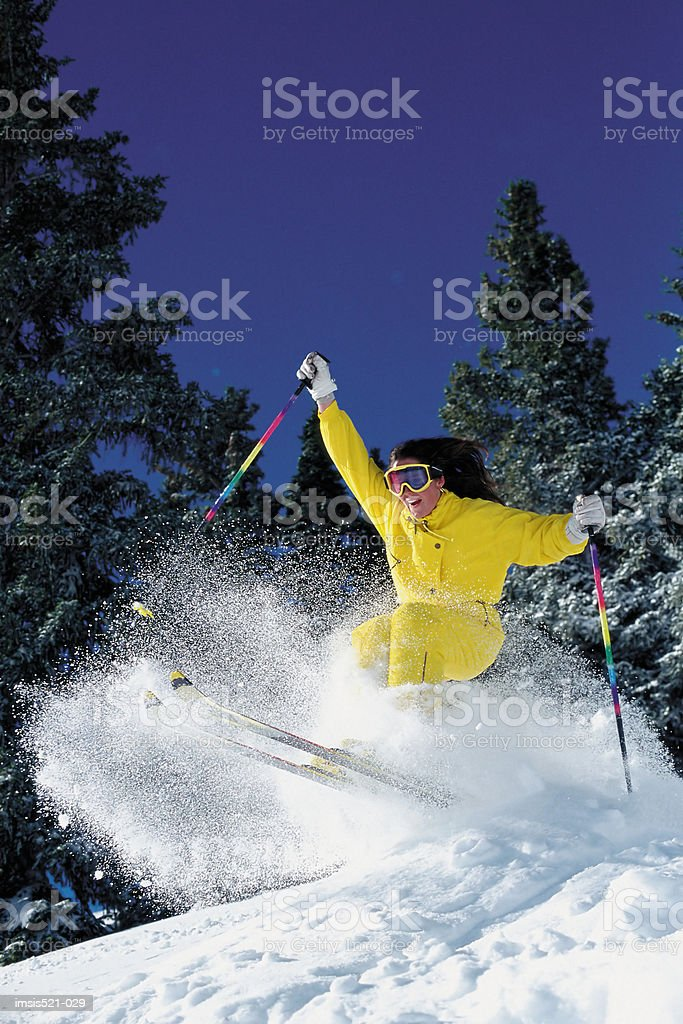 Woman off-piste skiing royalty-free stock photo