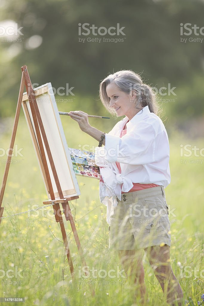Woman Oil Painting On Canvas Outdoors royalty-free stock photo