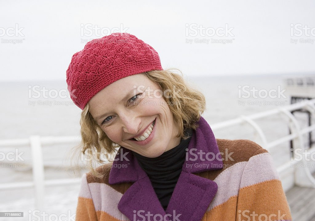 A woman on a boardwalk at the beach royalty-free stock photo