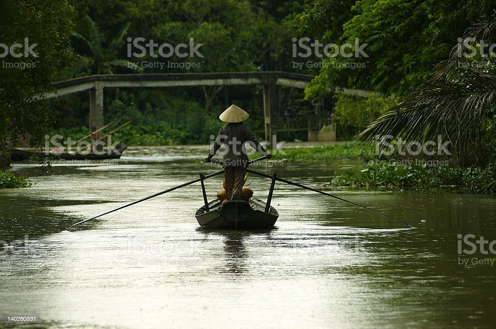 Woman on a boat in Vietnam stock photo