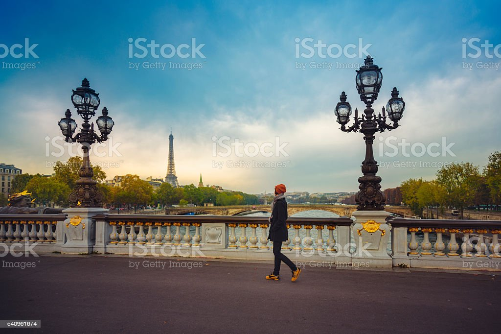 Woman on a bridge in Paris stock photo