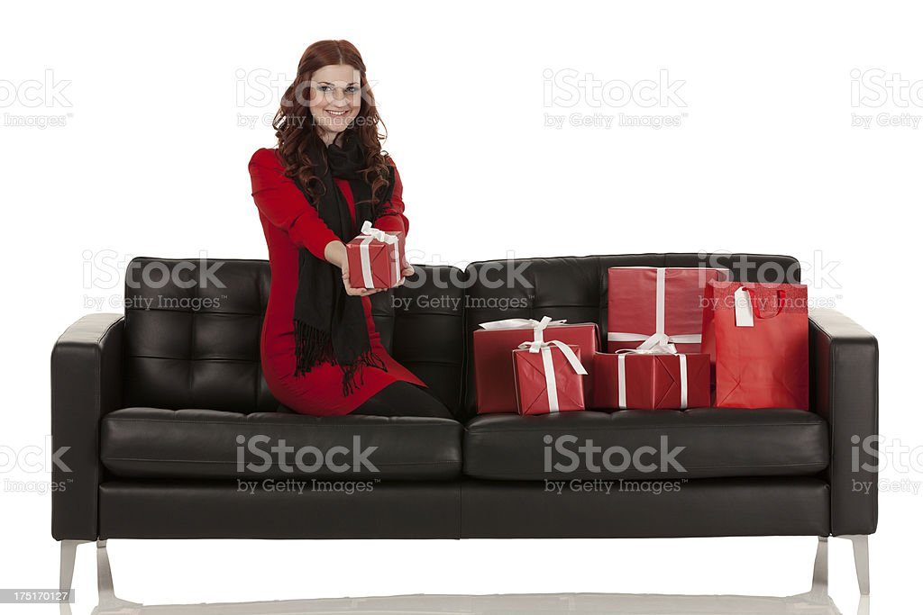 Woman on a couch with presents royalty-free stock photo