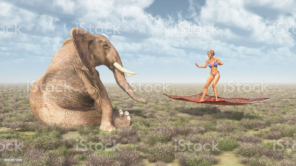 Woman on a flying carpet and sitting elephant stock photo