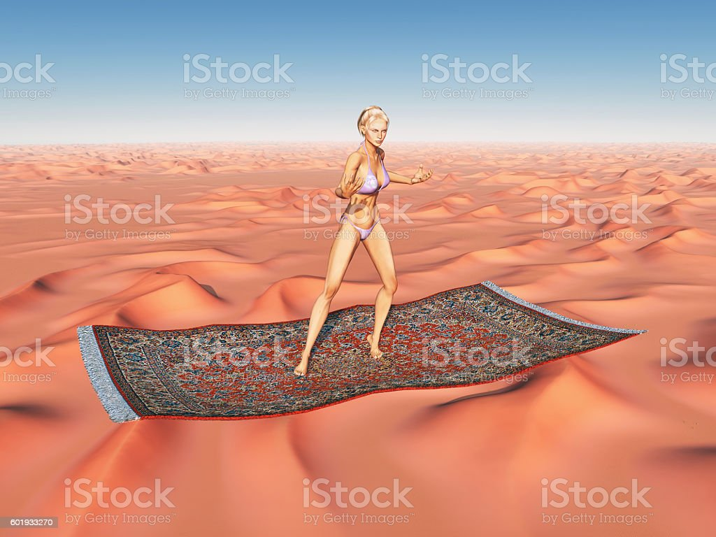 Woman on a flying carpet over a desert stock photo