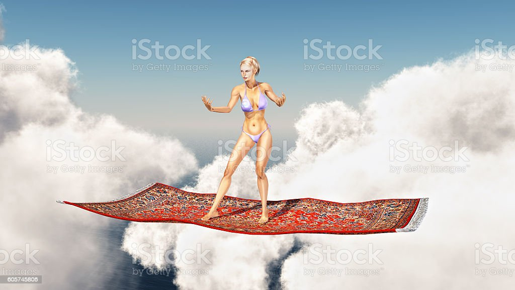 Woman on a flying carpet over the clouds stock photo