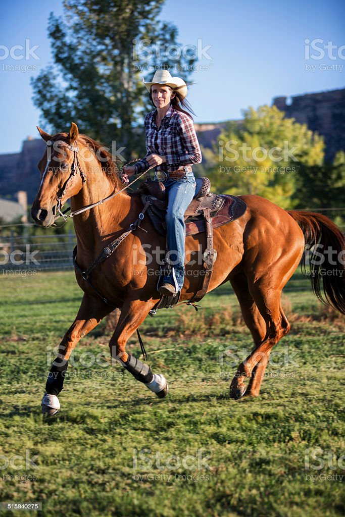 Woman on a Galloping Horse stock photo
