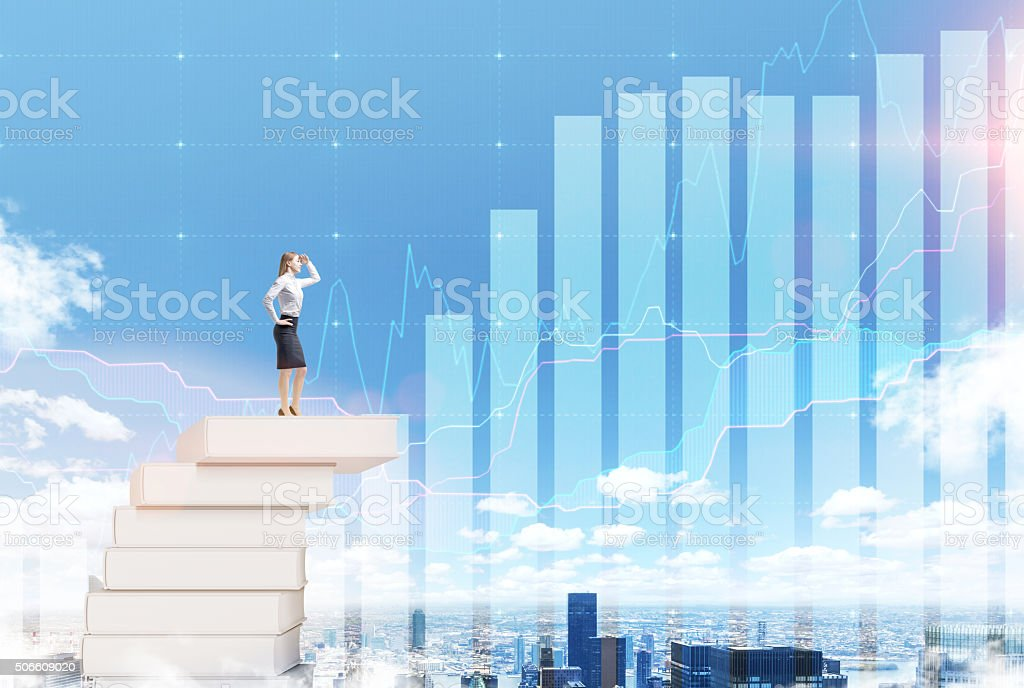 Woman on a pile of books stock photo