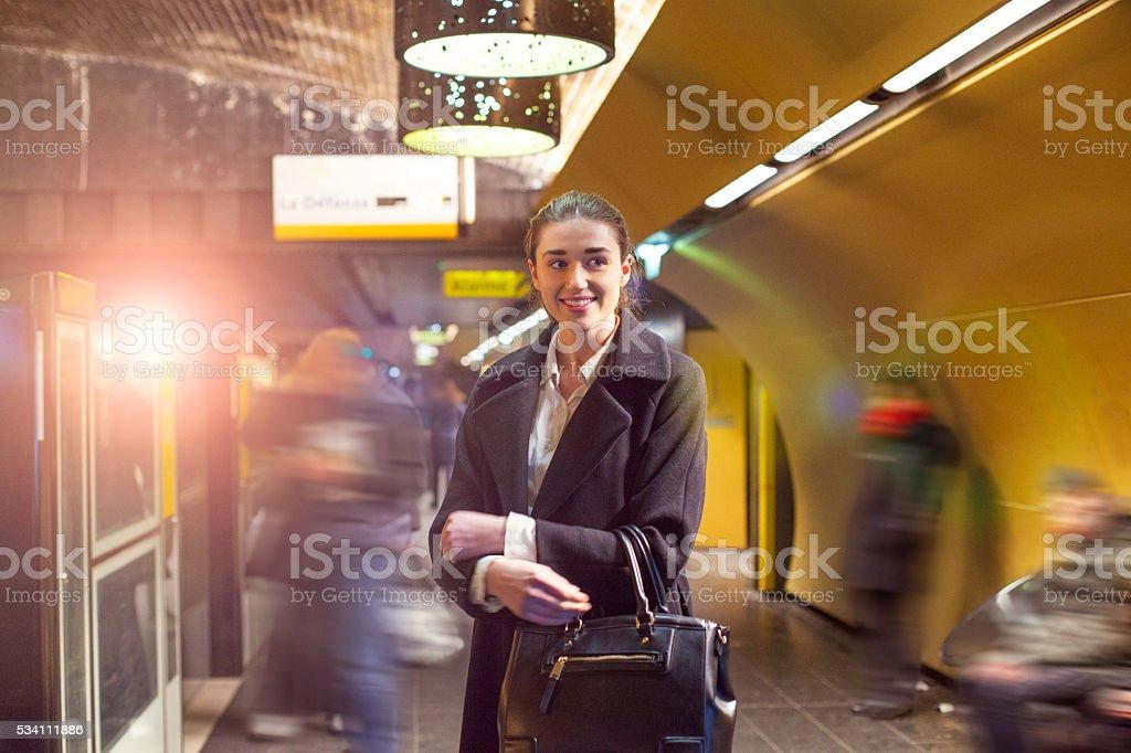 Woman on a platform of Paris subway (Metro). stock photo